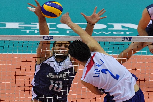 Andreas Andreadis of Greece blocks against Hong-Jie Liu of Chinese Taipei attacks
