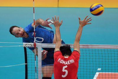 Farhad Ghaemi of Iran blocks against Jose Luis Gonzalez of Argentina spikes